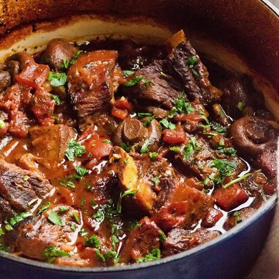 Easy Braised Short Ribs - Whole brown mushrooms, diced tomatoes and honey soy glazed fall of the bone meat.