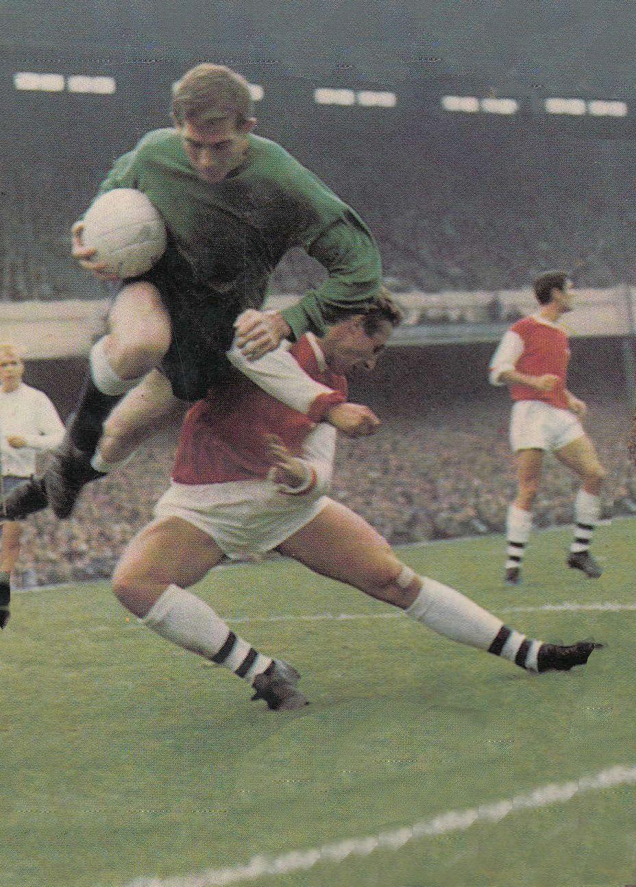 e02632c24 16th September 1967. Tottenham Hotspur goalkeeper Pat Jennings taking  evasive action to avoid Arsenal forward John Radford