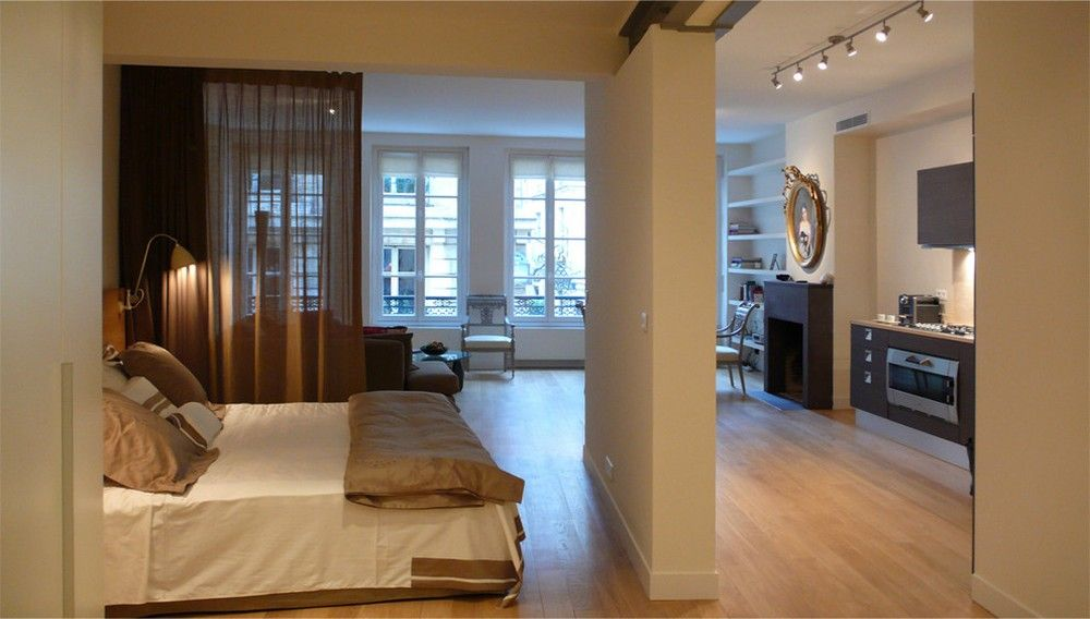 wood floor small bedroom. Small Bedroom Space Behind The White Wall Panel In Hallway With Modern  Bed On Wooden