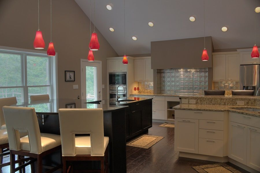 upscale kitchen two toned cabinetry large custom hood two