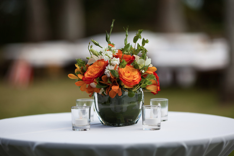 Orange White Green Flowers Set In Small Glass Vase On