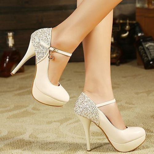 Cream Colored Heels with a Thin Ankle Strap & Crystal Studs on the Heels.