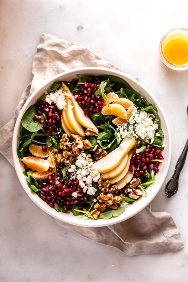 Photo of Winter salad with pears and pomegranates – blue bowl