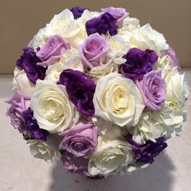 Wedding bouquet of white roses hydrangea purple
