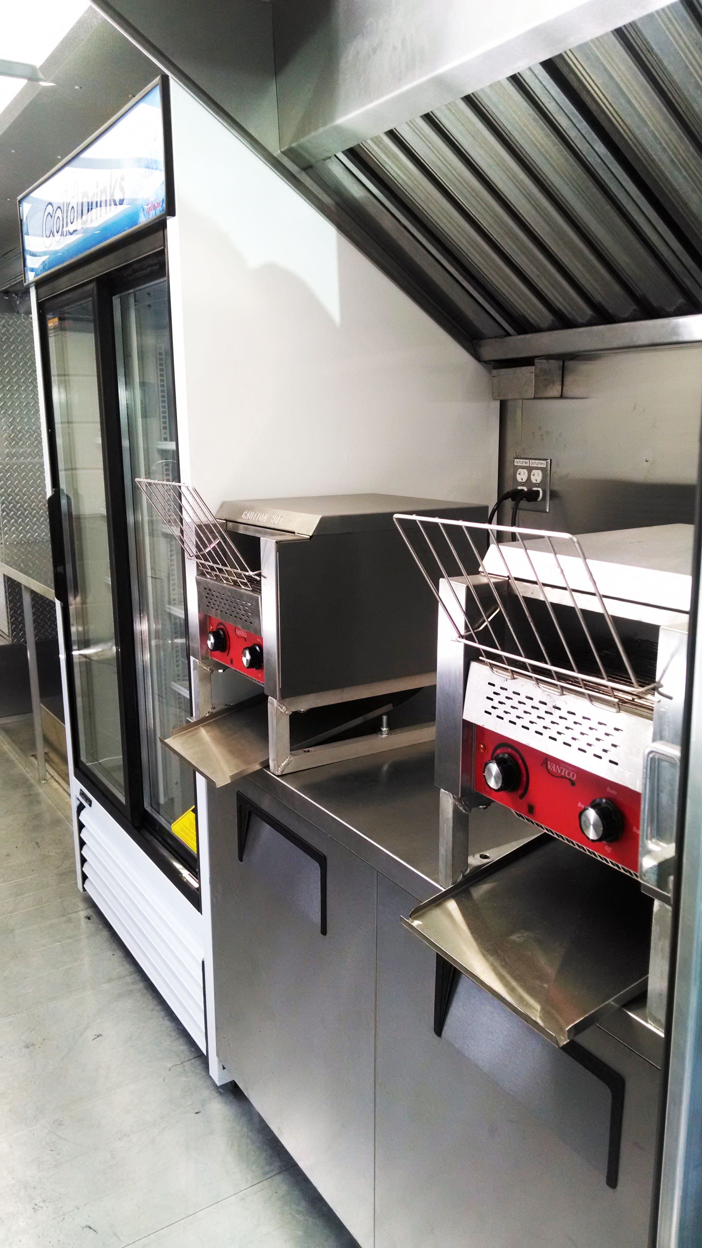 4 Ft Stainless Steel Hood Refrigerated Sandwich Prep Table Two Conveyor Toasters And A Merchandiser Refrigerator Custom Mobilekitchen Foodtrucks