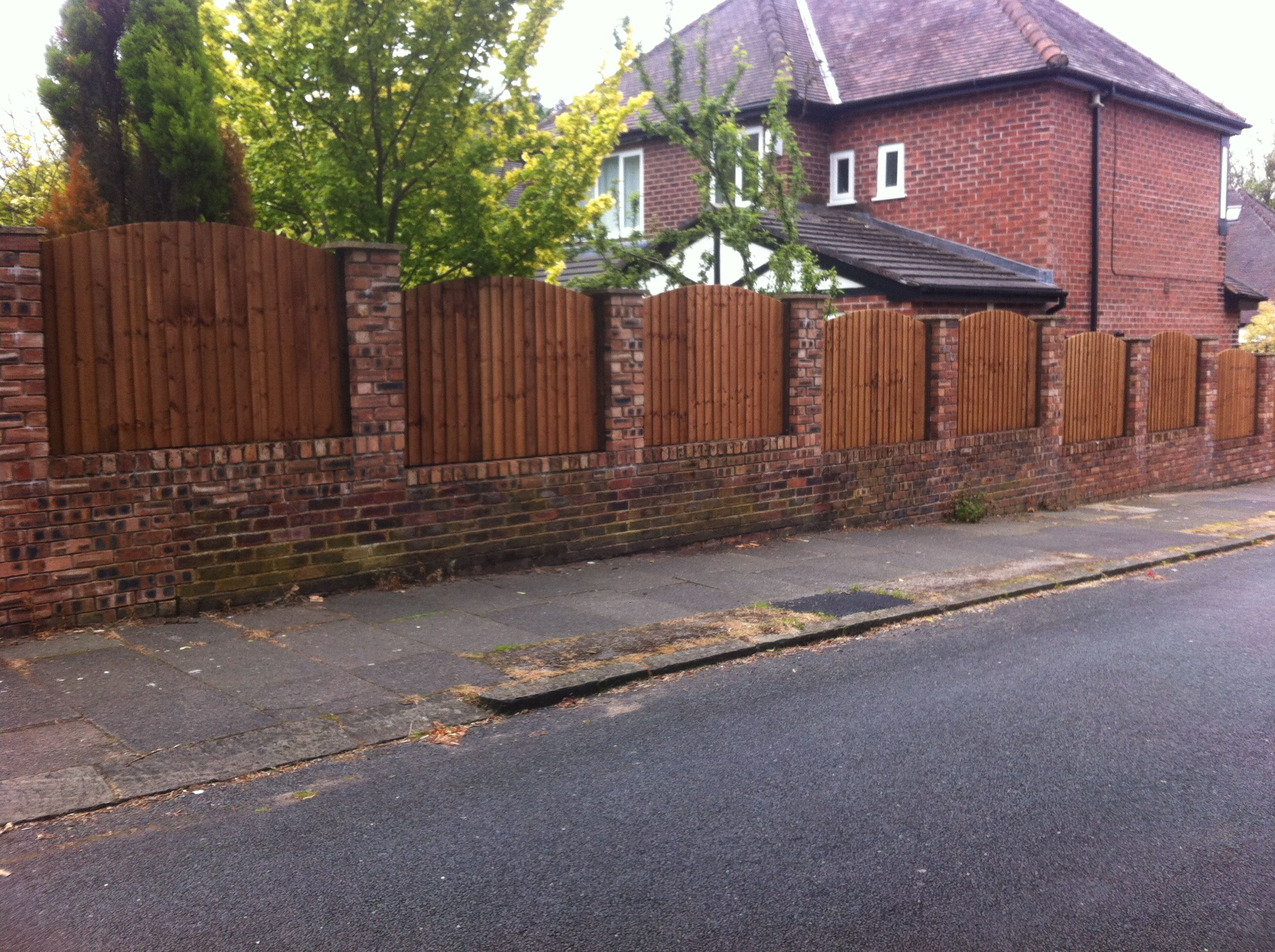 New fencing fitted to existing brick pillars in Middleton ...