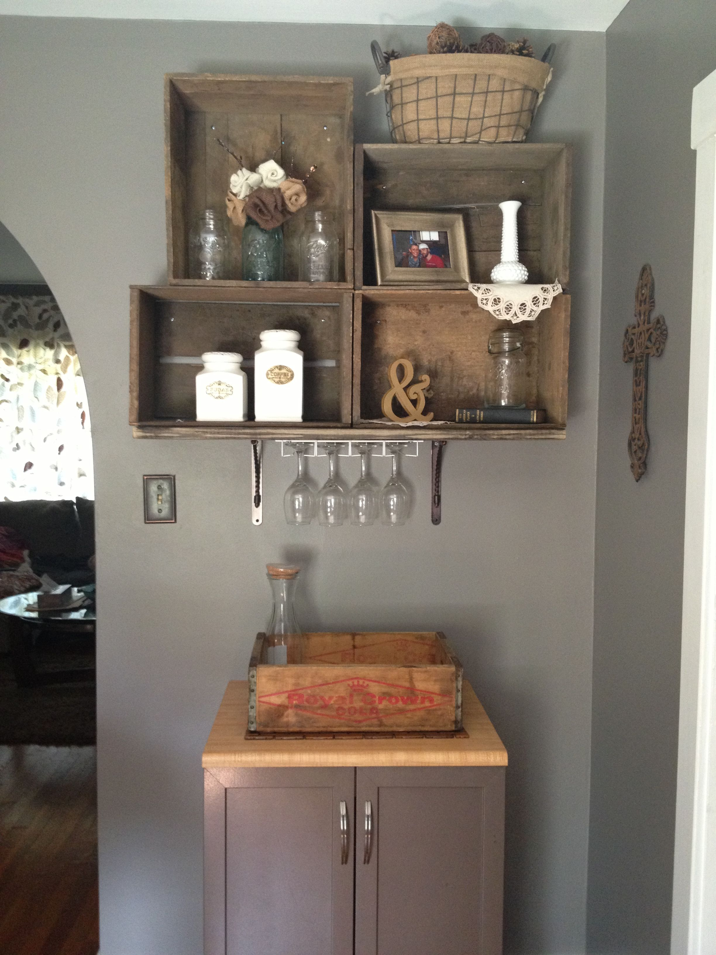 Old wooden boxes bolted to the wall wine bar and coffee for Crate wine rack diy