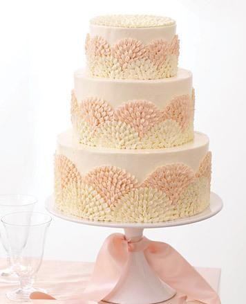 Wendy Kromer Covered Each Tier Of The Cake In Swiss Meringue Ercream Then Created A Repeated Flourish With Petal Tip Which Gives Modern