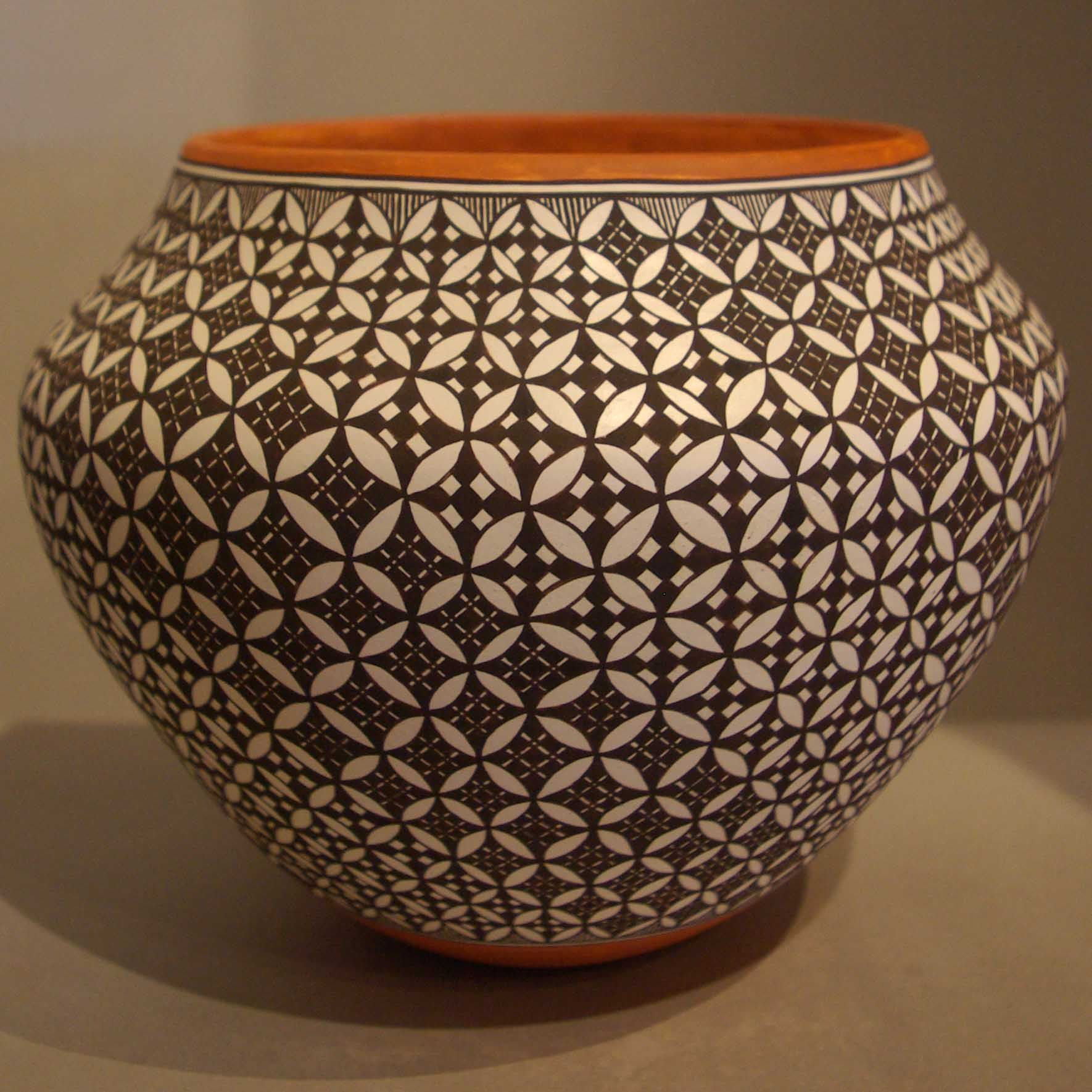 Pueblo: Acoma Artist: Amanda Lucario Date Created: 2013 Dimensions: 6 in H by 7 1/2 in Dia Item Number: xxack3151 Price: $ 1750 Description: Water jar with swirl geometric design New Arrival
