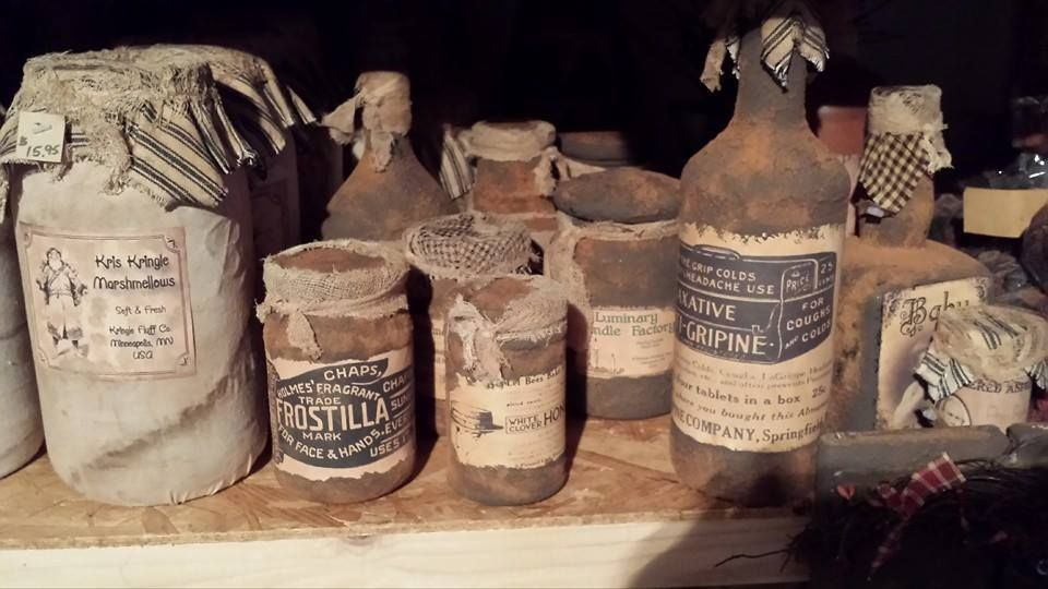 Grungy jars, made from wine bottles, mayonnaise jars, jelly and pickle jars.
