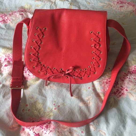 Violetta messenger bag Red/coral violetta cross body bag. Except for the scratch in the front, this bag is in new condition. Comes with its own dust bag!! Very adorable bag!!! Violetta Bags Crossbody Bags