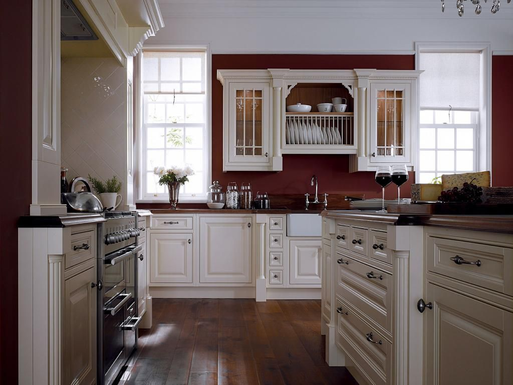 White cabinets and moldings contrast perfectly with for Kitchen ideas white cabinets red walls