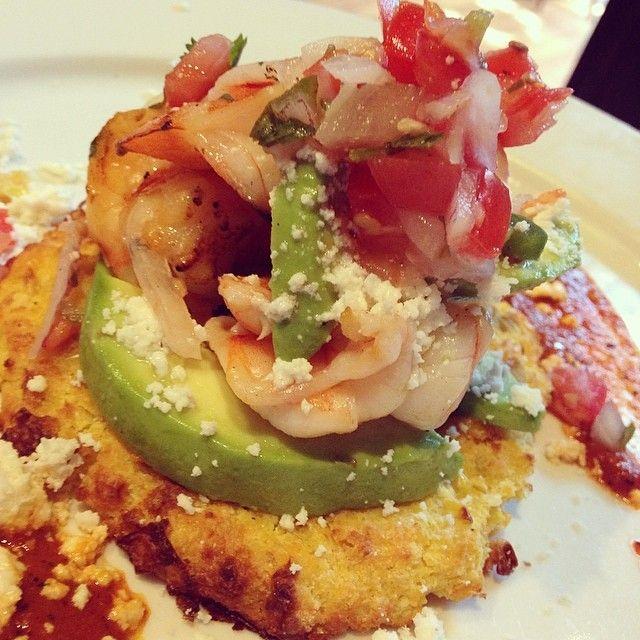 corn arepa with shrimp salad avocado and chipotle