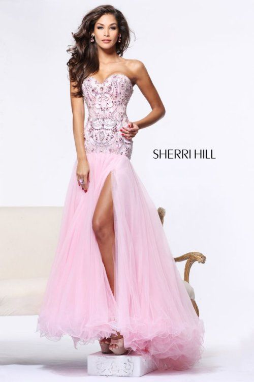 This pink gown features a embellished strapless bodice and long ...