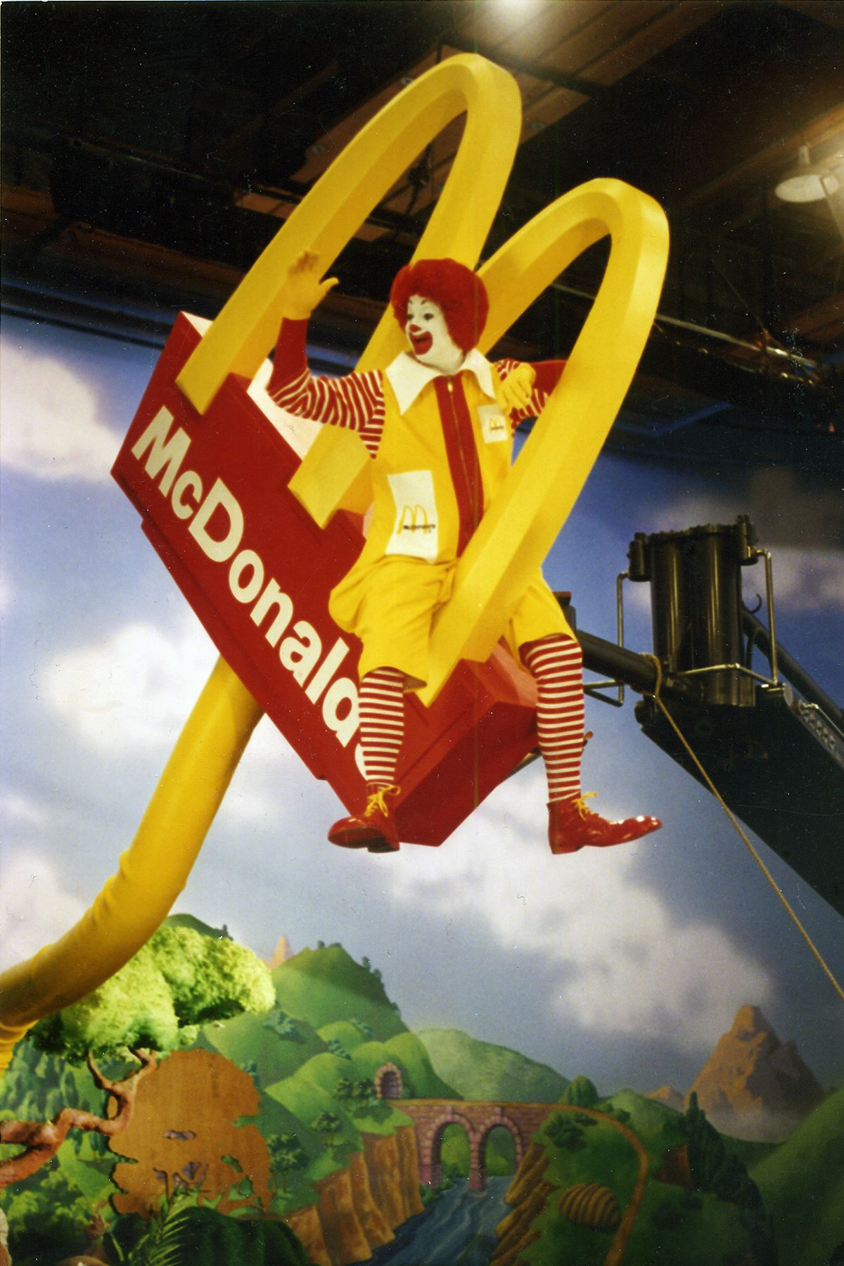 Ronald McDonald and his friends plant a small golden arch