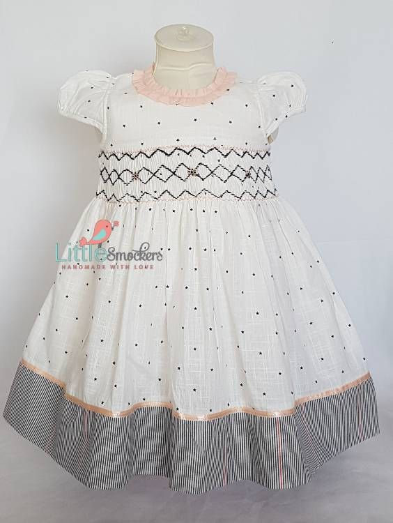232137ae31d7 This stunning little toddler dress is made with a 100% cotton white ...