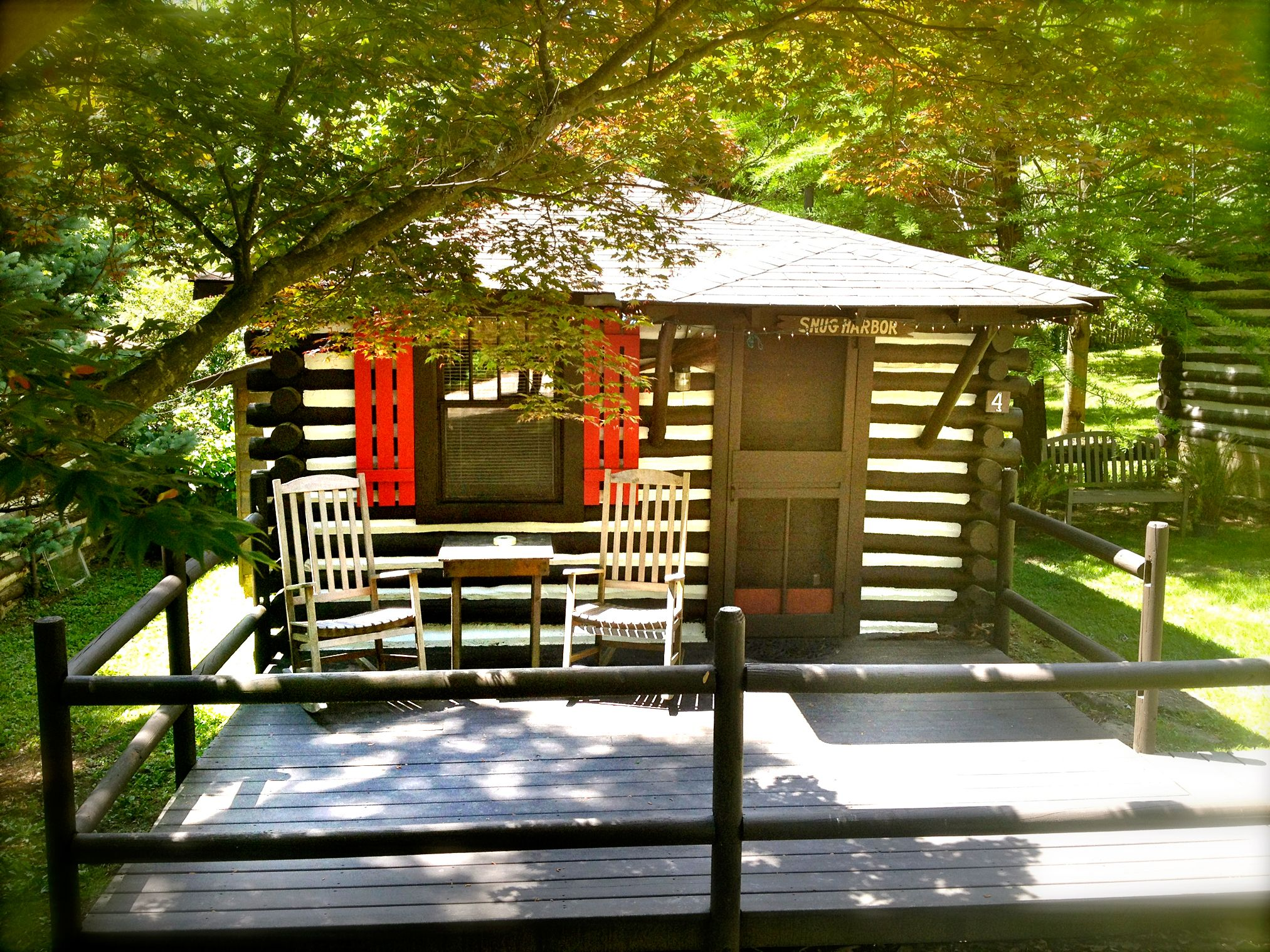 the rentals rafting treehouse getaway springs a deck cabin on with estate nc near in and fireplace cabins tub asheville hot biltmore romantic
