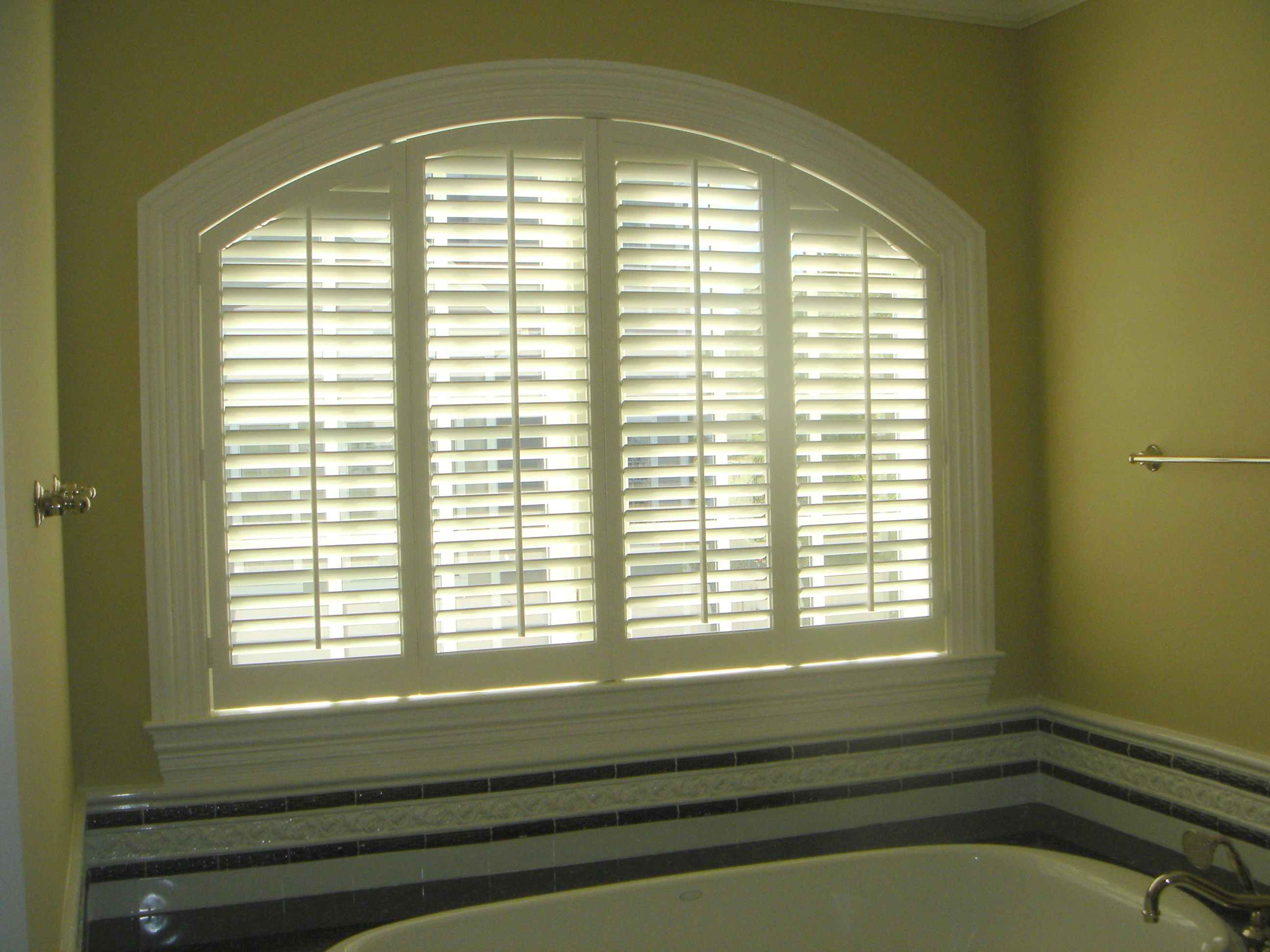 Big Window Over A Tub With A Great Window Covered With Plantation Shutters Shutters By The