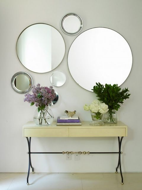Asymmetrical Round Mirror Layout Still Centered Above The