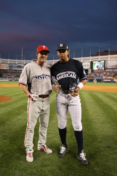 3722be18e52 Chase Utley  26 of the Philadelphia Phillies and Alex Rodriguez  13 of the  New York Yankees hold his MVP trophy during the State Farm Home Run Derby  at the ...