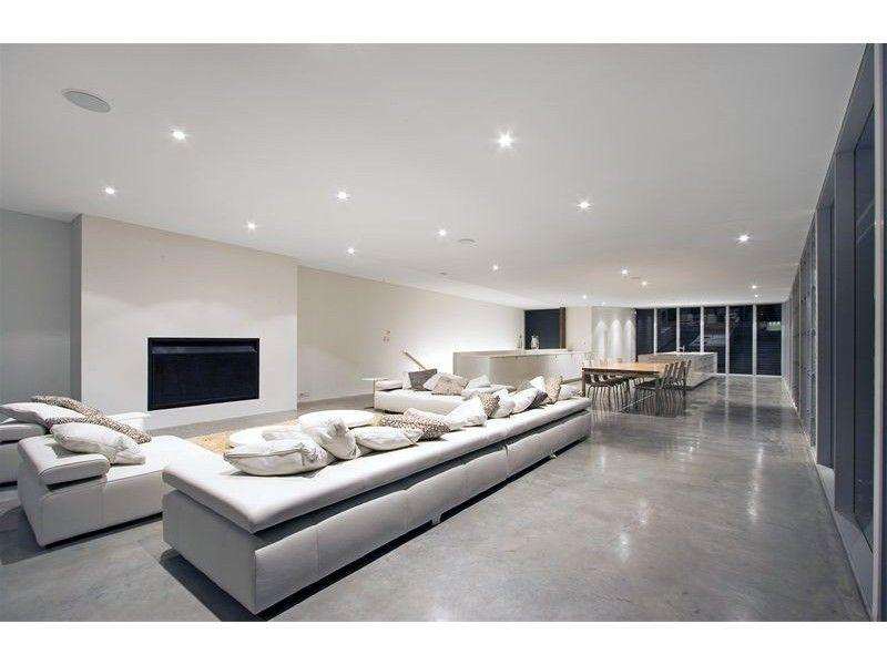 Polished concrete material homehound living room - Concrete floor living room ...