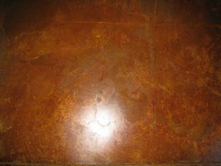 Acid-stained concrete - can be used indoors or outdoors for a beautiful look that won't fade over time.