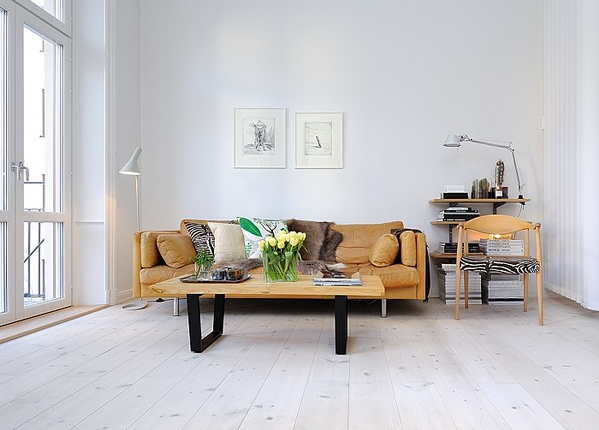 Whitewashed Wood Floors, Yellow Couch, White Walls. Clean Meets Warm