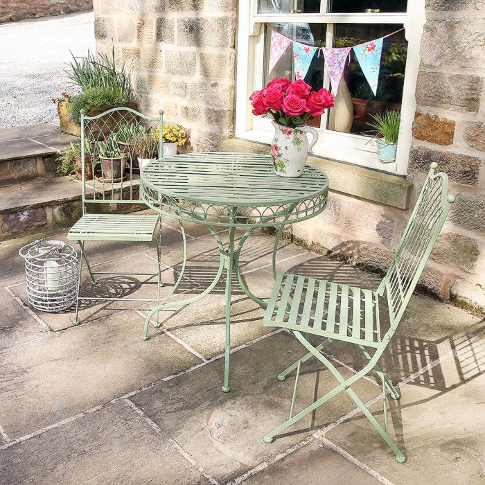 A Timeless Set Consisting Of A Round Table And Two Chairs Beautifully Designed Garden Furniture Made Outdoor Patio Decor Garden Table And Chairs Backyard Decor