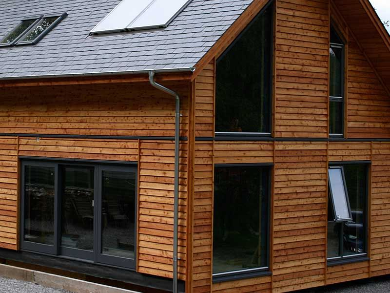 Douglas Fir Feather Edge Building With White Windows