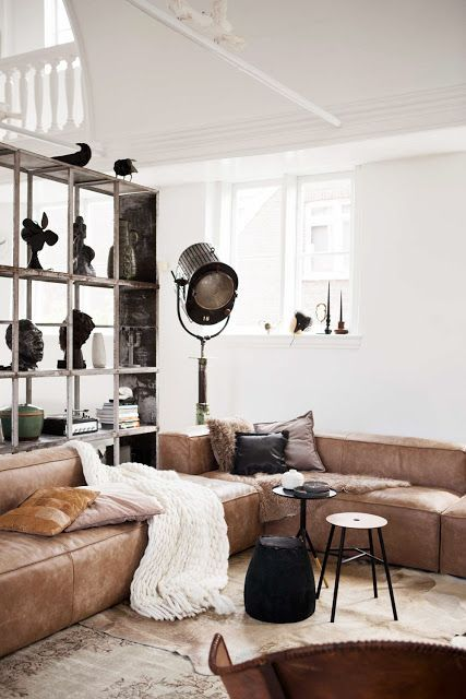 a large corner brown leather sofa for an industrial-inspired space ...