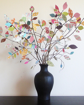 DIY Scrapbook Tree. Would be nice to use last years Christmas cards on white glitter branches