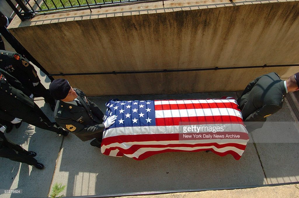 The flagdraped casket of Pfc. Le Ron Wilson is carried by