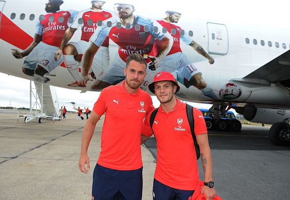 Aaron Ramsey and Jack Wilshere in front of the Emirates plane as they travel to Singapore for the Barclays Asia Trophy.