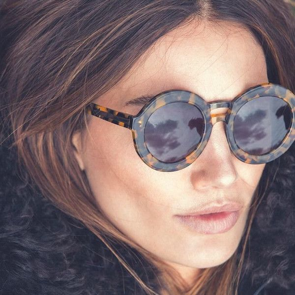 ...and Sports Some Seriously Chic Shades