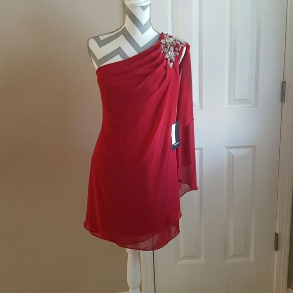 """JS Boutique Red One Shoulder Embellished Chiffon Red One Shoulder Embellished Chiffon dress brand new with tags. It is a US size 8. This hot read chiffon dress is very """"grecian goddess """" like. It has jewels on the shoulder and a side zipper. It's been stored in a smoke free home. I do offer bundle deals as well, thank you for checking out my closet. Here is the website with product information:  http://www.edressme.com/beaded-one-shoulder-jersey-cocktail-dresses-by-js-boutique.html J.S…"""