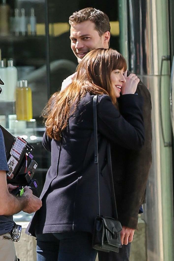 Jamie Dornan as Christian Grey and Dakota Johnson as ...