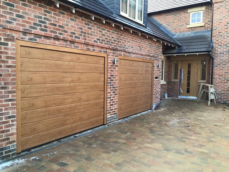 X 2 Hormann Sectional Garage Doors In Winchester Oak Www.bradgatedoors.co.uk