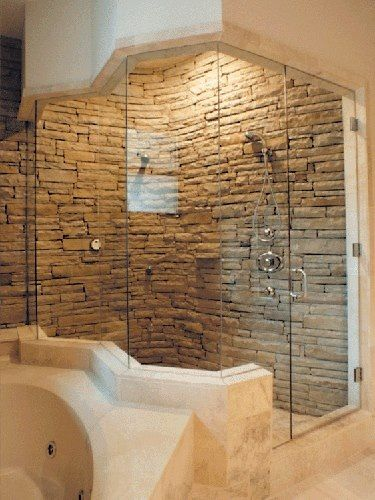Double shower head rock wall shower! Love it   My kind of home decor ...