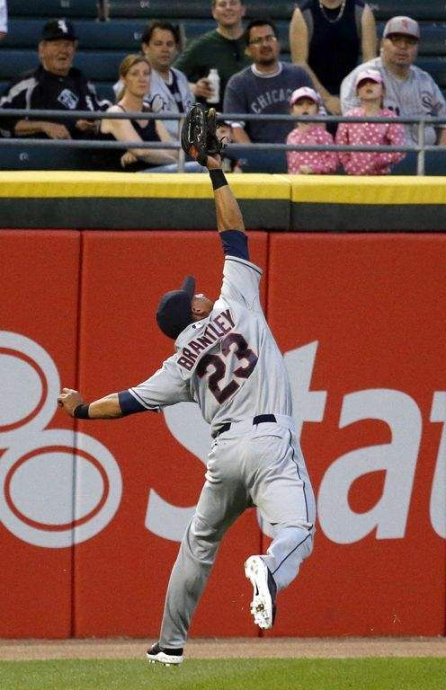 Cleveland Indians left fielder Michael Brantley (23) catches a line drive off the bat of Chicago White Sox's Adam Eaton during the first inn...