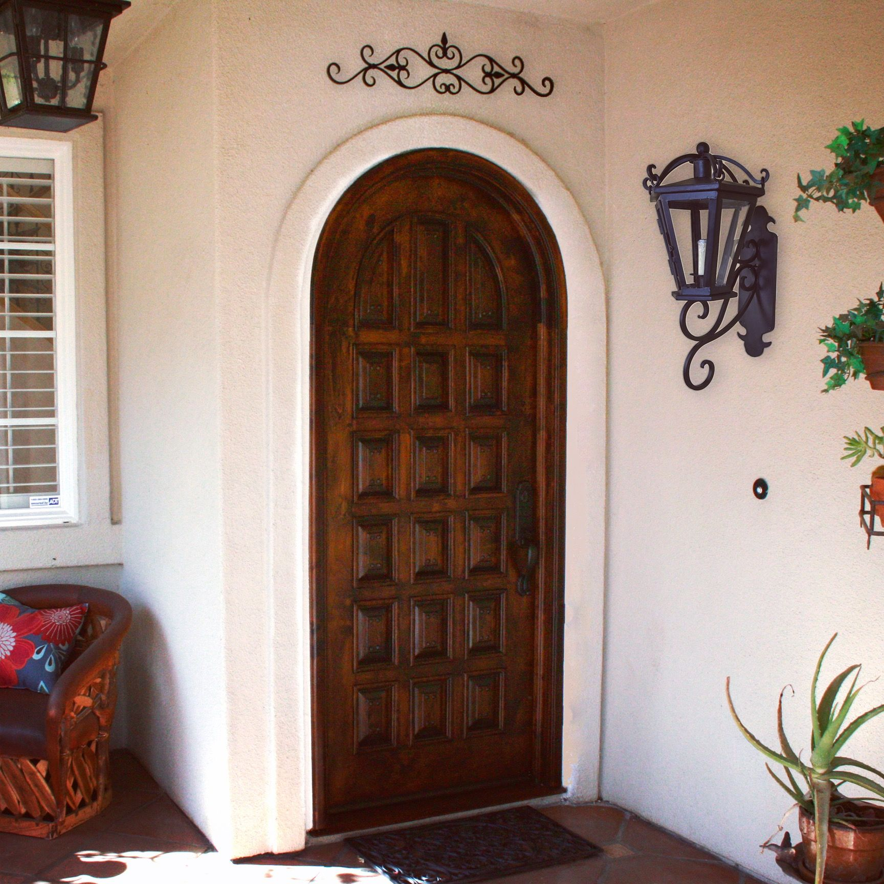 A classic, Spanish entry door stands out in this suburban, Southern California home!