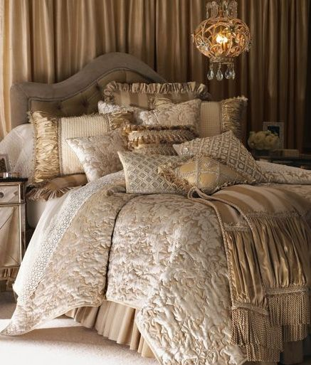 Love the luxuriousness of this bed.  It shows how you can subtly mix patterns for a rich effect.  Works with event linens as well.