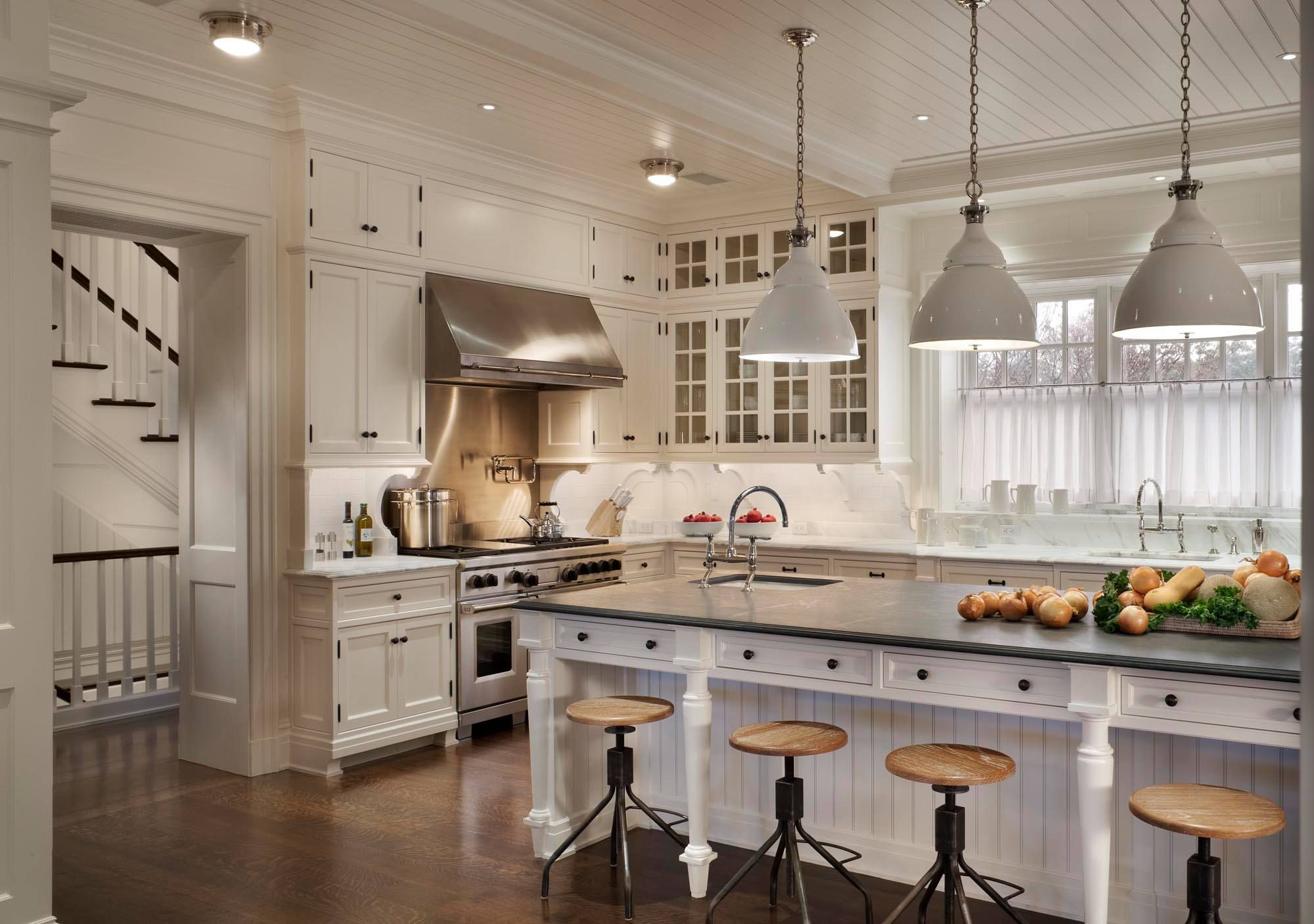 Industrial style stools and pendant lights for a white kitchen