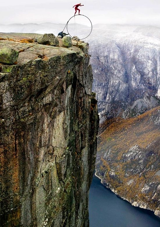 Feet On The Edge Of A Cliff