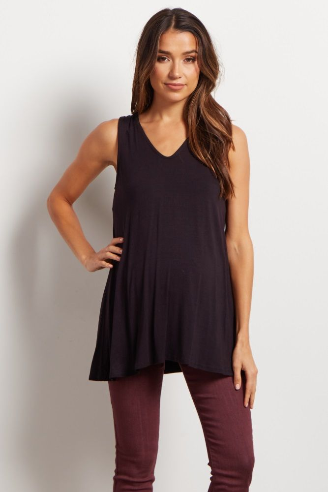 9da1d62f735a4 This basic tank makes layering a breeze. The rounded v neckline and flowy  silhouette means you can easily wear it alone or underneath sheer blouses.