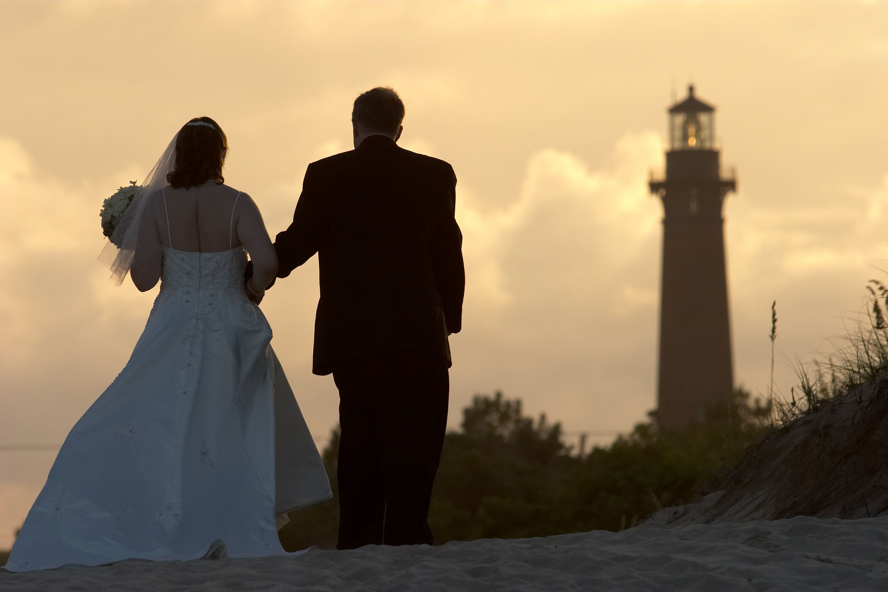 The Currituck Lighthouse makes a beautiful backdrop.  Photo by Mary Basnight Photography www.engagingeventsobx.com #engagingeventsobx #curritucklighthouse