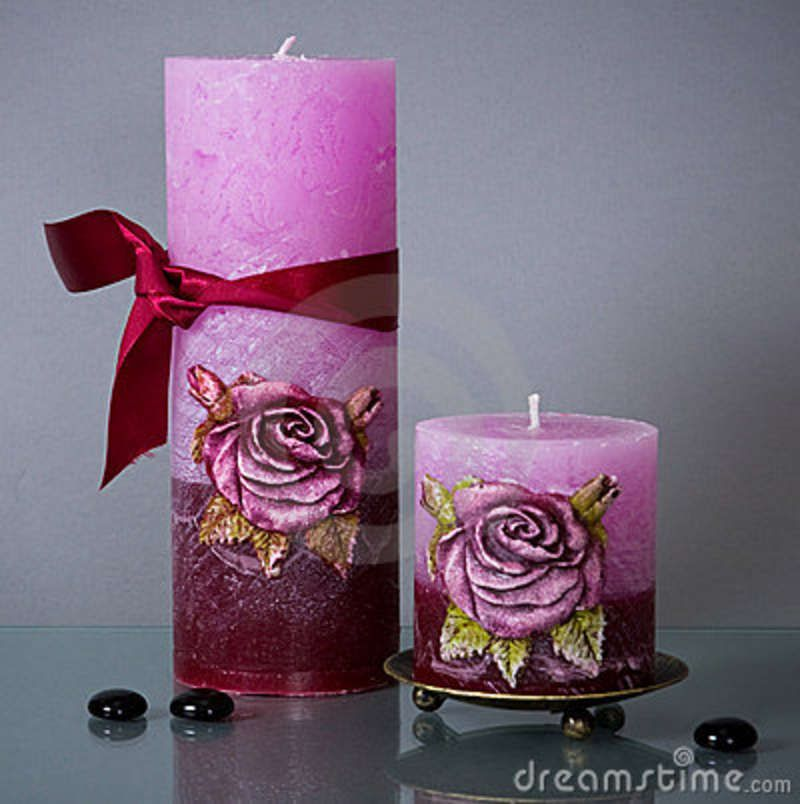 http://thumbs.dreamstime.com/z/two-round-candles-red-ribbon-5166381.jpg