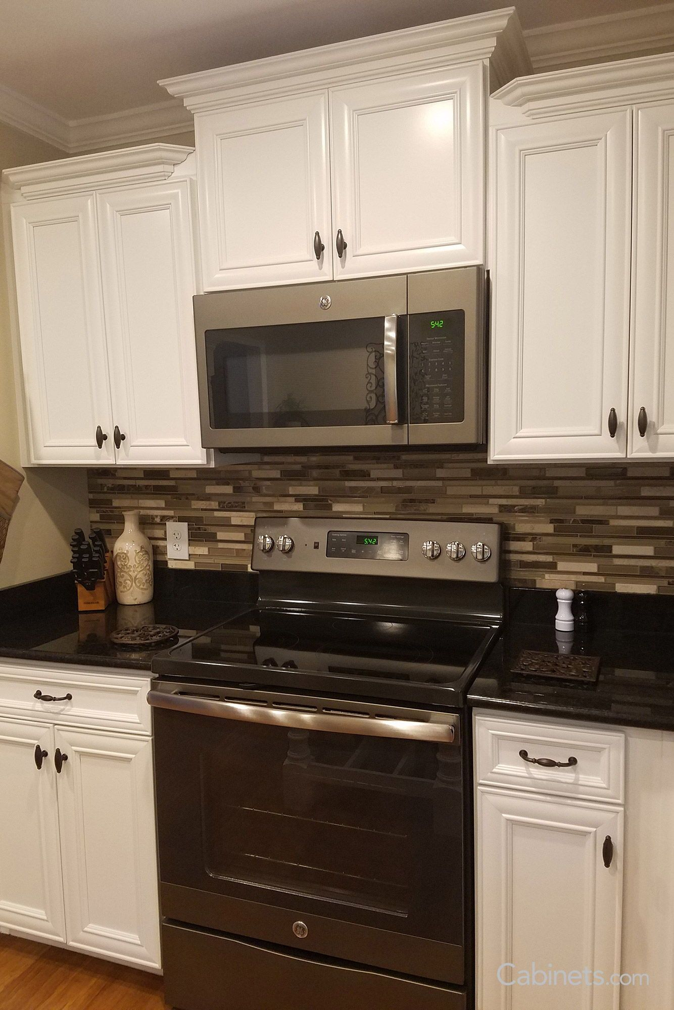Black And White Kitchen With A Linear Glass Mosaic Tile Backsplash