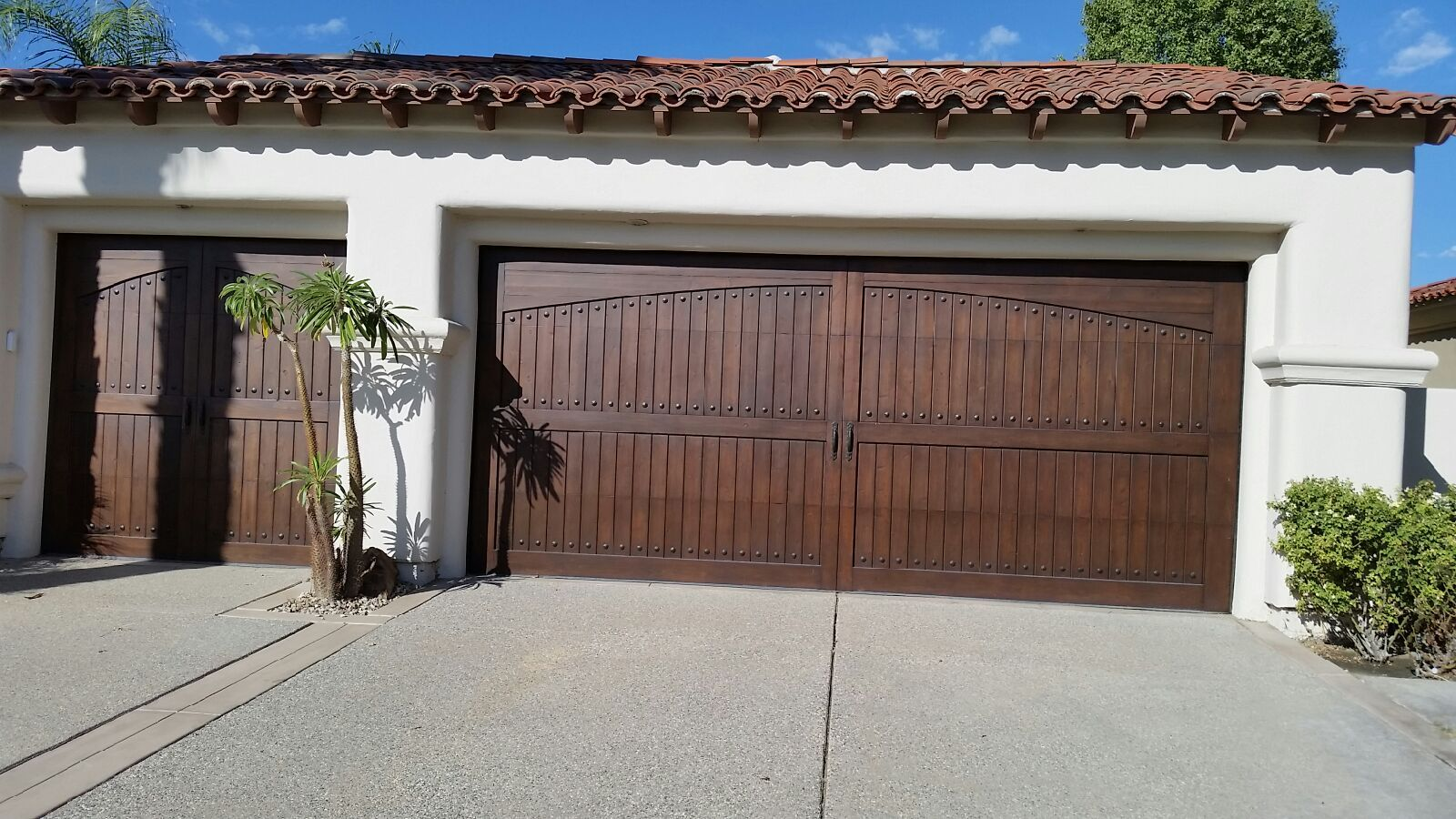 Eligant Dark Stain On Single Arch Vertical Cedar Garage Door Garage Door Styles Garage Door Types Garage Doors