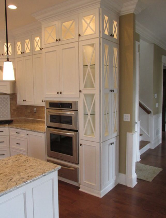 Tall White Narrow Cabinets, Top Lit, Glass Doors, Light Counters, Hardwood  Flooring, Tan Walls