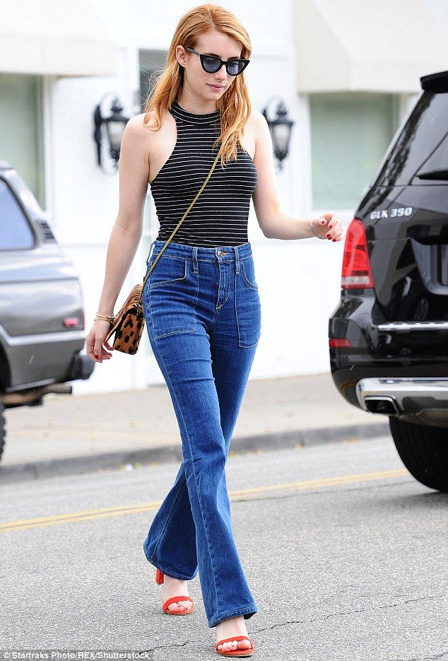 Braless Emma Roberts shows it is all in the jeans in trendy flares ...